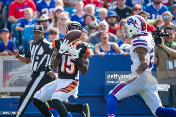 John Ross of the Cincinnati Bengals makes a touchdown reception during the first quarter as Jordan Poyer of the Buffalo Bills defends at New Era...