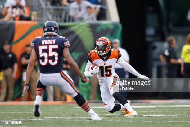 John Ross of the Cincinnati Bengals returns a punt in the first quarter of a preseason game against the Chicago Bears at Paul Brown Stadium on August...