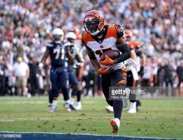 John Ross of the Cincinnati Bengals run in after his catch for a touchdown to trail 1412 to the Los Angeles Chargers during the second quarter at...