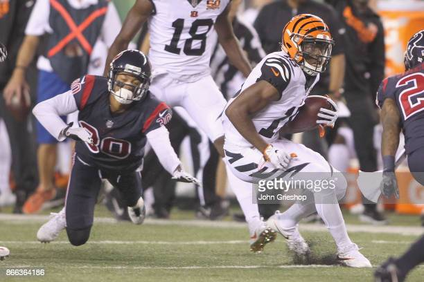 John Ross of the Cincinnati Bengals runs the football upfield against Kevin Johnson of the Houston Texans during their game at Paul Brown Stadium on...