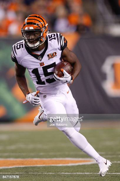 John Ross of the Cincinnati Bengals runs with the ball against the Houston Texans during the first half at Paul Brown Stadium on September 14 2017 in...