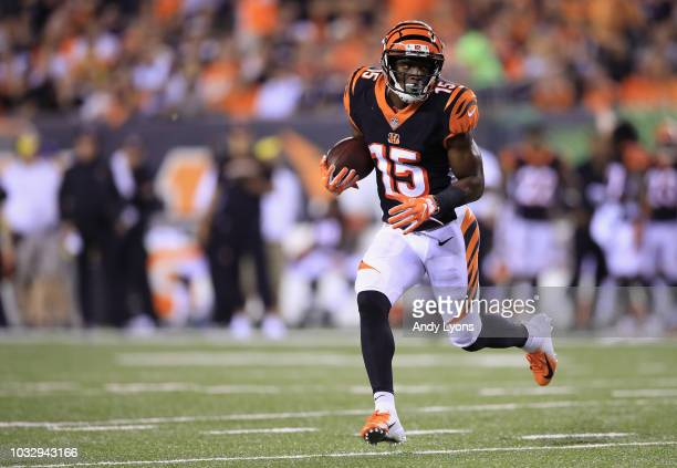 John Ross of the Cincinnati Bengals runs with the ball during the first half against the Baltimore Ravens at Paul Brown Stadium on September 13 2018...