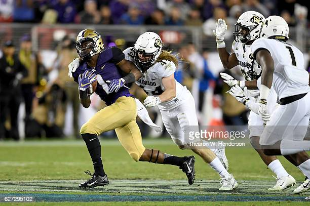 John Ross of the Washington Huskies is tackled by Addison Gillam of the Colorado Buffaloes during the Pac12 Championship game at Levi's Stadium on...