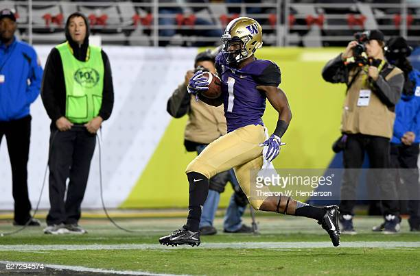 John Ross of the Washington Huskies runs in for a touchdown against the Colorado Buffaloes during the Pac12 Championship game at Levi's Stadium on...