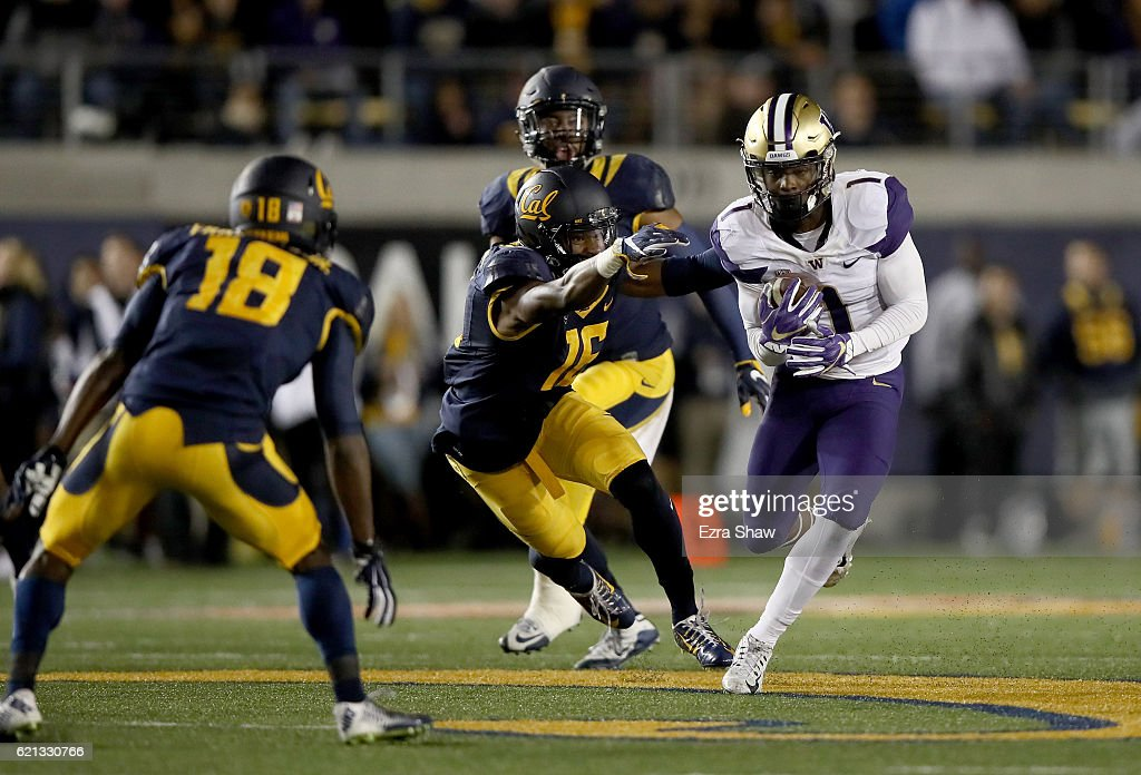 John Ross #1 of the Washington Huskies runs with the ball after making a catch against the California Golden Bears at California Memorial Stadium on November 5, 2016 in Berkeley, California.