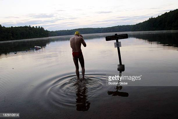 John Rouke of Belmont a long time early morning swimmer at Walden Pond gets ready to enter the water at 530 am on Thursday