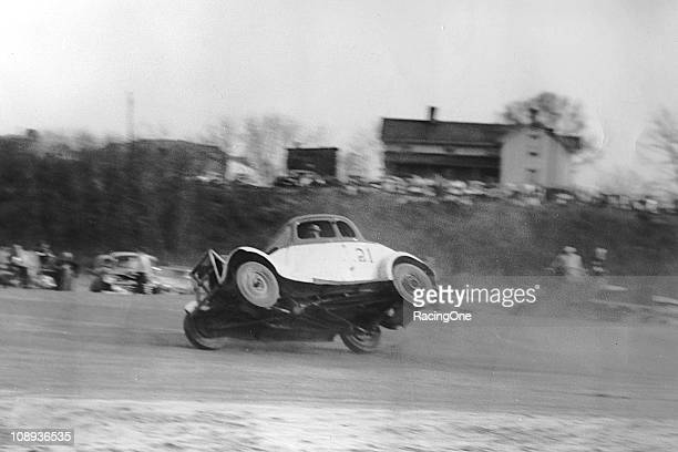 John Ruaker gets his stock car up on two wheels during a race at Cumberland County Speedway