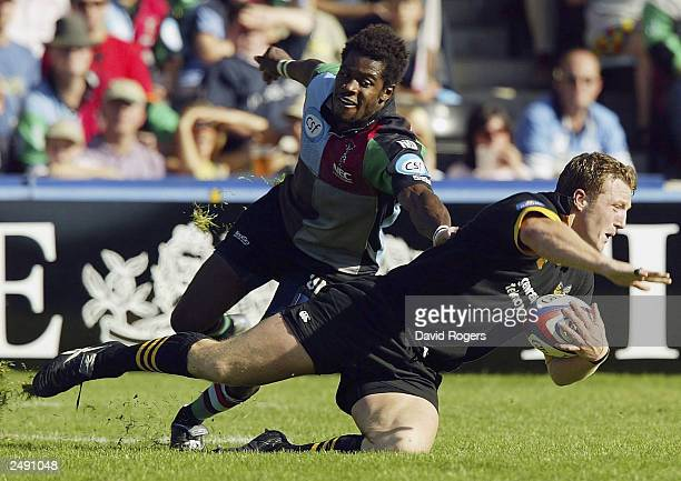 John Rudd of Wasps is tackled by Ugo Monye of Harlequins during the Zurich Premiership match between Harlequins and Wasps at the Stoop Ground...