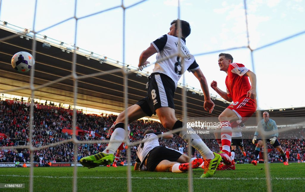 John Ruddy (R) and Jonathan Howson (C) of Norwich City look on as Sam Gallagher of Southampton scores their fourth goal during the Barclays Premier League match between Southampton and Norwich City at St Mary's Stadium on March 15, 2014 in Southampton, England.