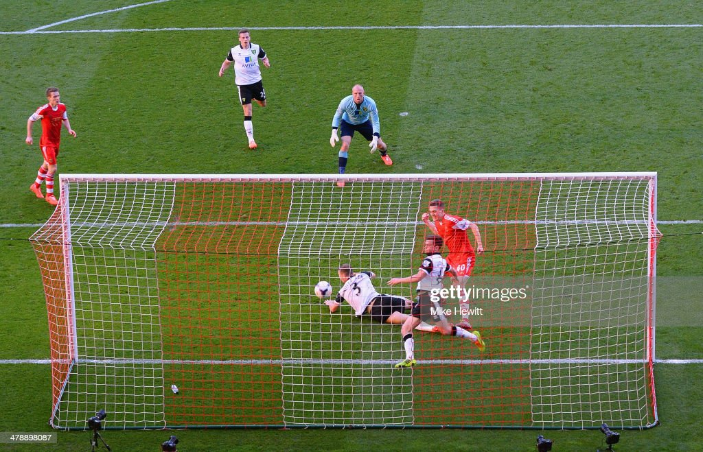 John Ruddy (C) and Jonathan Howson of Norwich City look on as Sam Gallagher of Southampton scores their fourth goal during the Barclays Premier League match between Southampton and Norwich City at St Mary's Stadium on March 15, 2014 in Southampton, England.