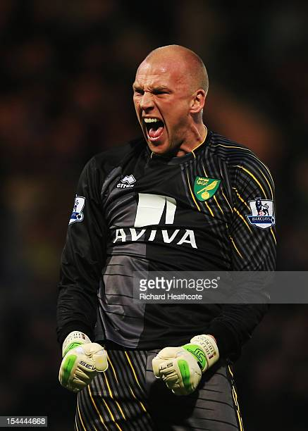 John Ruddy of Norwich City celebrates as Grant Holt scores their first goal during the Barclays Premier League match between Norwich City and Arsenal...