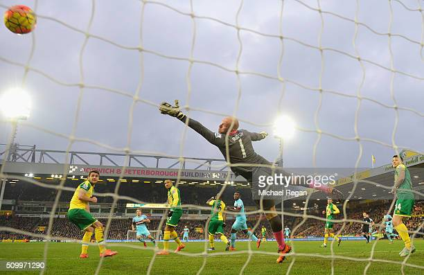 John Ruddy of Norwich City dives in vain as Mark Noble of West Ham United scores his team's second goal during the Barclays Premier League match...