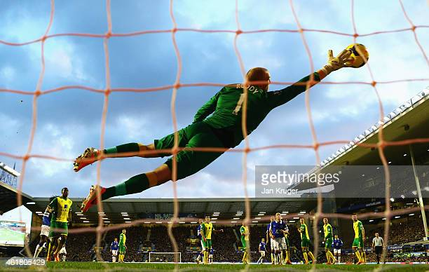 John Ruddy of Norwich City fails to stop the free kick by Kevin Mirallas of Everton during the Barclays Premier League match between Everton and...