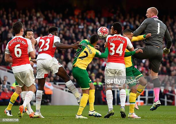 John Ruddy of Norwich City jumps for a header in the Arsenal penalty box during the Barclays Premier League match between Arsenal and Norwich City at...