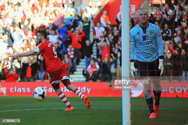 John Ruddy of Norwich City reacts as Jay Rodriguez of Southampton turns to celebrate scoring their third goal during the Barclays Premier League...