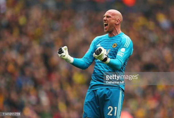 John Ruddy of Wolverhampton Wanderers celebrates as Matt Doherty scores his team's first goal with team mates during the FA Cup Semi Final match...
