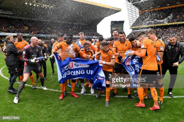 John Ruddy of Wolverhampton Wanderers spays players of Wolverhampton Wanderers with champagne as they celebrate promotion to the Premier League...