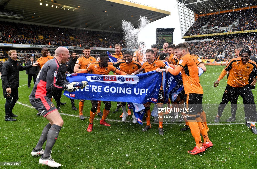 John Ruddy of Wolverhampton Wanderers spays players of Wolverhampton Wanderers with champagne as they celebrate promotion to the Premier League during the Sky Bet Championship match between Wolverhampton Wanderers and Birmingham City at Molineux on April 15, 2018 in Wolverhampton, England.