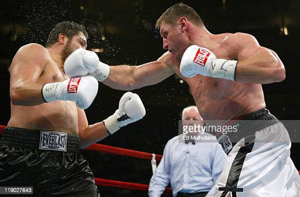 John Ruiz and Andrew Golota trade punches during their 12 round heavyweight championship bout at Madison Square Garden in New York City on November...