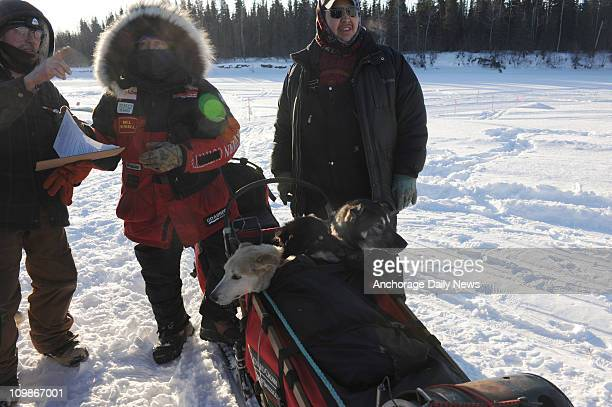 John Runkle checks in Paul Gebhardt at the Nikolai Alaska checkpoint during the Iditarod Trail Sled Dog Race on Tuesday March 8 2011