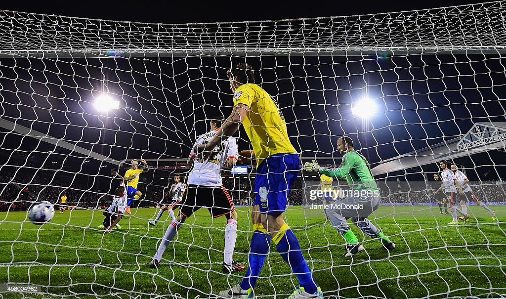 John Russell of Derby County scores his goal during the Capital One Cup fourth round match between Fulham Derby County at Craven Cottage on October 28, 2014 in London, England.