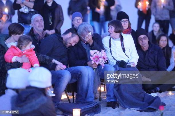 SYDNEY NSW John Ruszczyk is joined by family and friends at a sunrise vigil for Justine Damond on Freshwater beach in Sydney New South Wales Justine...