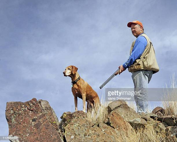 John Ryan and his hunting dog Jasmine look for signs of chukars above Brownlee Reservoir in Idaho September 27 2007 Chukars are the blue collar bird...