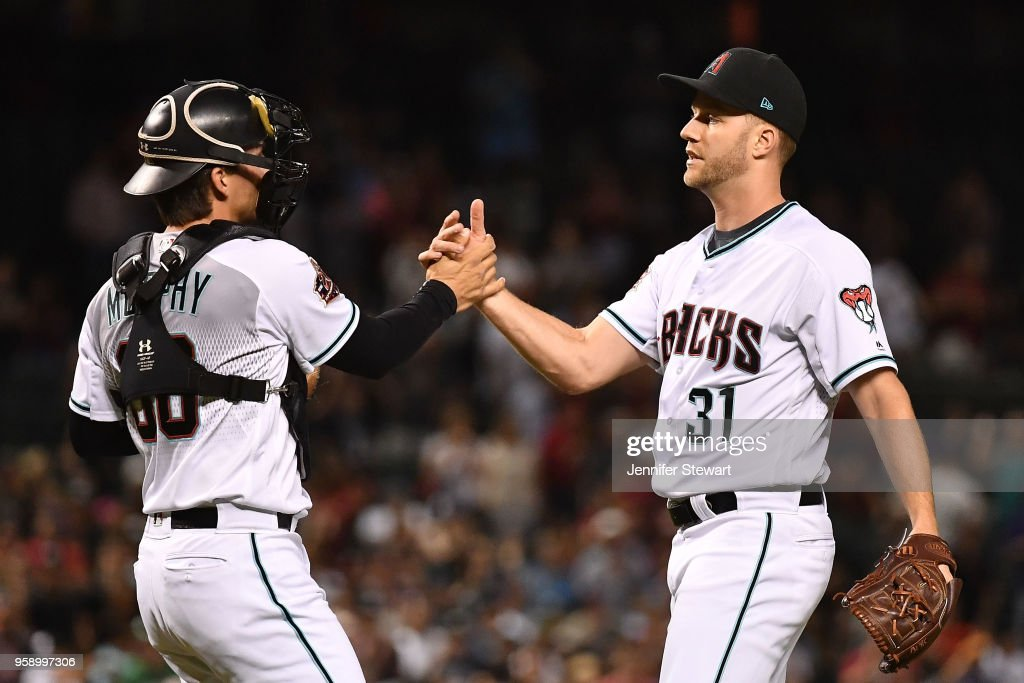 John Ryan Murphy #36 and Brad Boxberger #31 of the Arizona Diamondbacks celebrate after closing out the game against the Milwaukee Brewers at Chase Field on May 15, 2018 in Phoenix, Arizona. The Arizona Diamondbacks won 2-1.