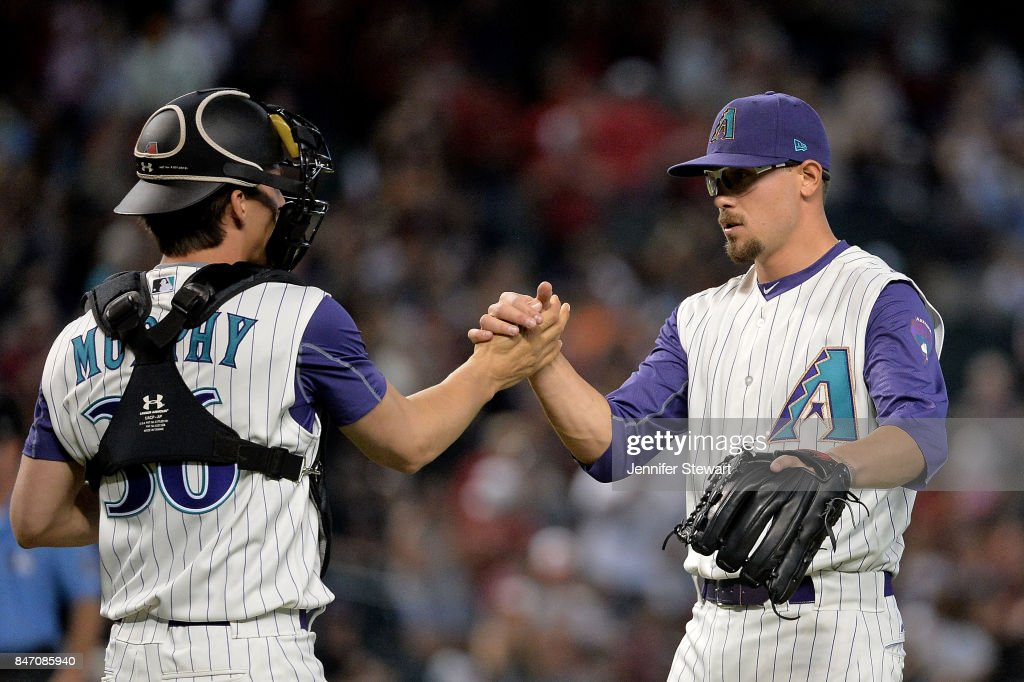 John Ryan Murphy #36 and Braden Shipley #34 of the Arizona Diamondbacks celebrate after closing ou the MLB game against the Colorado Rockies at Chase Field on September 14, 2017 in Phoenix, Arizona.
