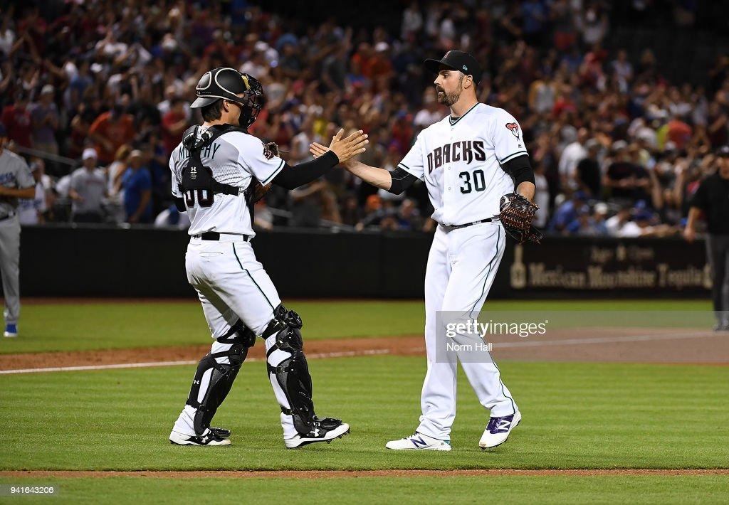 John Ryan Murphy #36 and TJ McFarland #30 of the Arizona Diamondbacks celebrate a 6-1 win against the Los Angeles Dodgers at Chase Field on April 3, 2018 in Phoenix, Arizona.