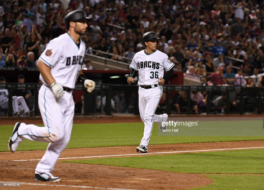 John Ryan Murphy #36 of the Arizona Diamondbacks scores on a bases loaded walk to teammate Paul Goldschmidt #44 during the seventh inning against the Los Angeles Dodgers at Chase Field on April 3, 2018 in Phoenix, Arizona.