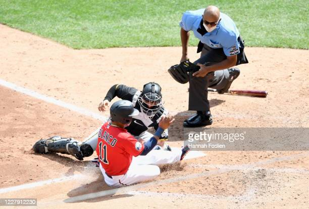 John Ryan Murphy of the Pittsburgh Pirates defends home plate from Jorge Polanco of the Minnesota Twins as umpire CB Bucknor looks on during the...