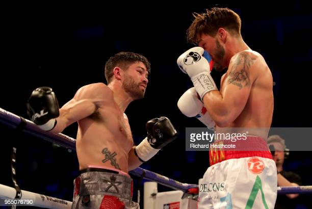 John Ryder punches Jamie Cox during SuperMiddleweight fight between John Ryder and Jamie Cox at The O2 Arena on May 5 2018 in London England