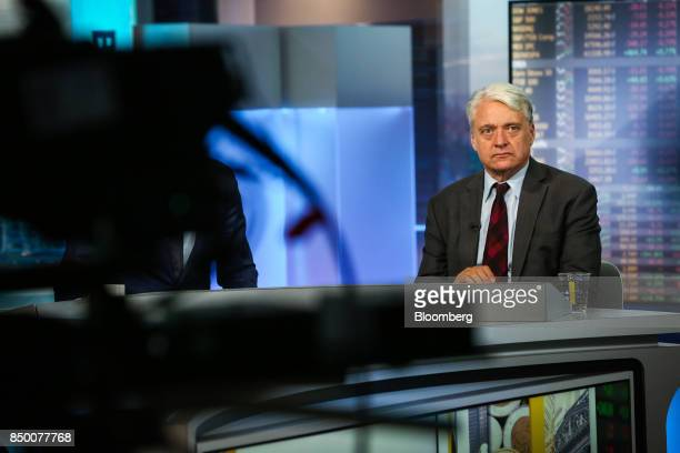 John Ryding cofounder and chief economist of RDQ Economics LLC listens during a Bloomberg Television interview in New York US on Wednesday Sept 20...