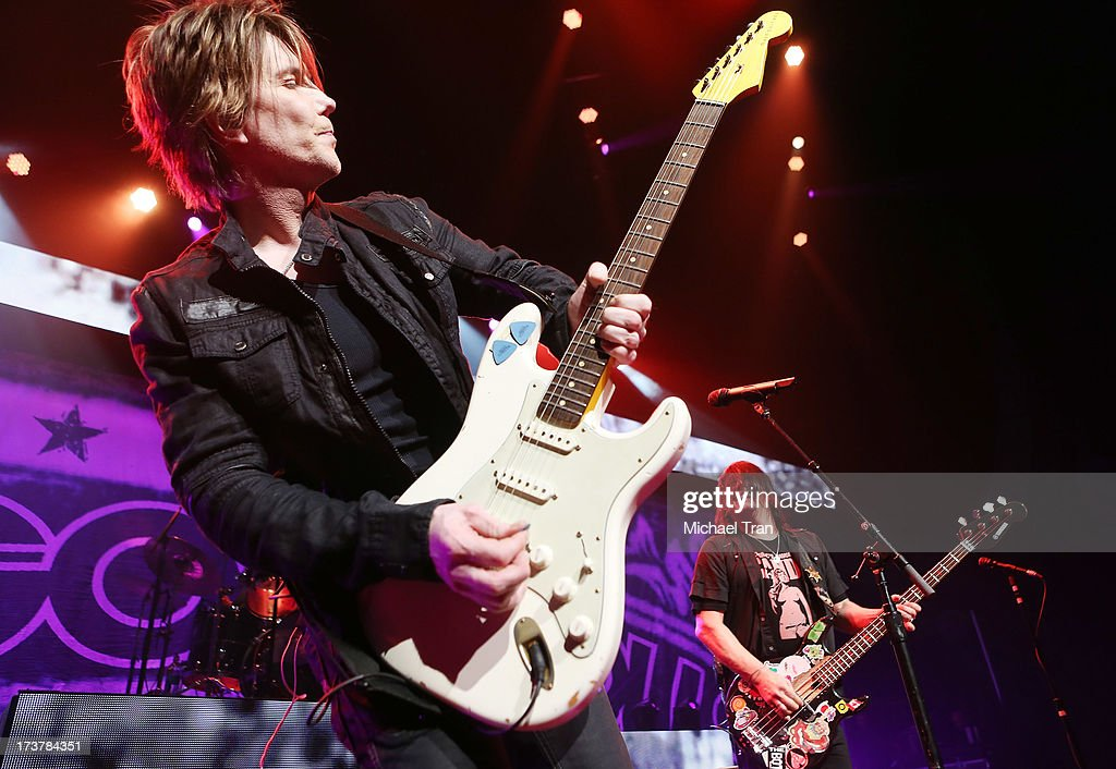 John Rzeznik (L) and Robby Takac of the Goo Goo Dolls perform onstage at Gibson Amphitheatre on July 17, 2013 in Universal City, California.