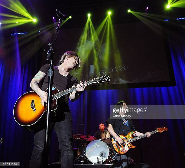 John Rzeznik Mike Malinin and Robby Takac of Goo Goo Dolls perform during the 2013 Star 94 Jingle Jam at Arena at Gwinnett Center on December 16 2013...