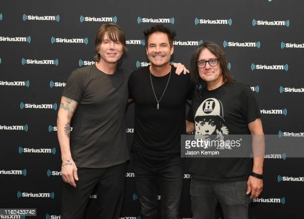 John Rzeznik of the Goo Goo Dolls Patrick Monahan of Train and Robby Takac of the Goo Goo Dolls visit Sirius XM studios on July 16 2019 in Nashville...