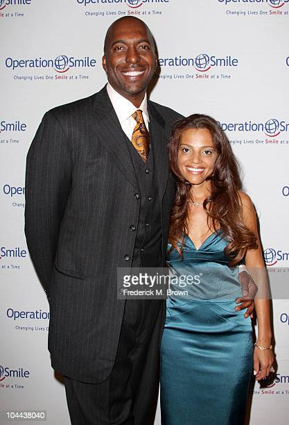 John Salley and his wife attend the Ninth annual Operation Smile gala at the Beverly Hilton Hotel on September 24 2010 in Beverly Hills California