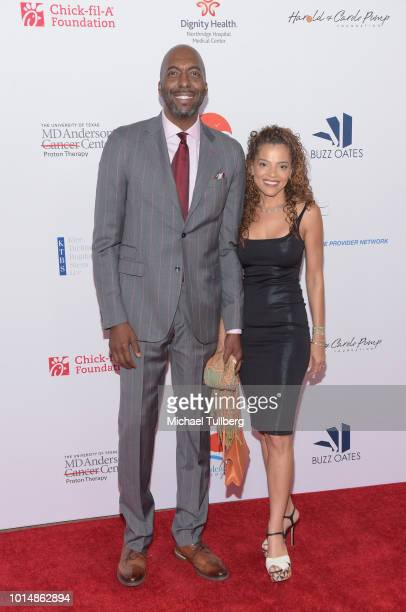 John Salley and wife natasha Salley attend the 18th Annual Harold and Carole Pump Foundation Gala at The Beverly Hilton Hotel on August 10 2018 in...