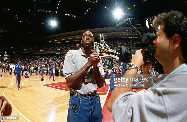John Salley is interveiwed courtside prior to Game One between the New York Knicks and the Houston Rockets during the NBA Finals played on June 8...