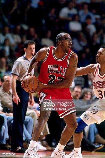 John Salley of the Chicago Bulls attempts a pass against the Philadelphia 76ers during a 1996 NBA game at the Comcast Center in Philadelphia...