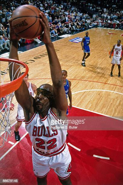 John Salley of the Chicago Bulls dunks against the Orlando Magic in Game One of the Eastern Conference Finals during the 1996 NBA Playoffs at the...