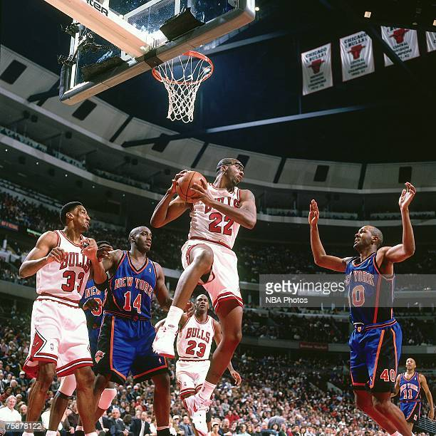 John Salley of the Chicago Bulls grabs a rebound against the New York Knicks during a 1996 NBA game at the United Center in Chicago Illinois NOTE TO...