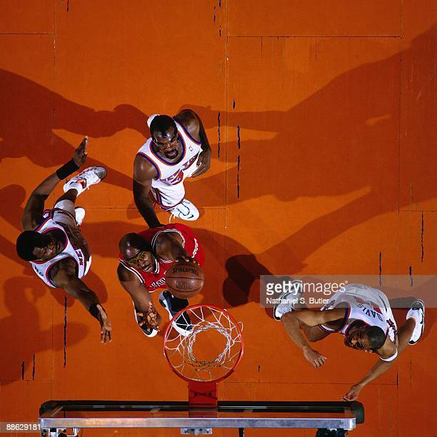 John Salley of the Chicago Bulls shoots a layup against a group of New York Knicks defenders in Game Four of the Eastern Conference Semifinals during...