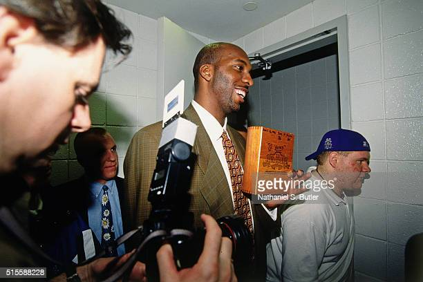 John Salley of the Chicago Bulls walks against the Milwaukee Bucks on April 16 1996 at the Bradley Center in Milwaukee Wisconsin NOTE TO USER User...