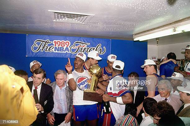 John Salley of the Detroit Pistons celebrates with the NBA Championship trophy after winning the 1989 NBA Title by defeating the Los Angeles Lakers...