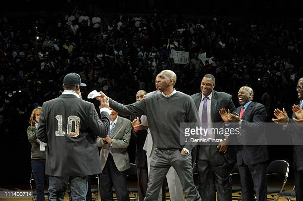 John Salley playfully hands former teammate Dennis Rodman a tissue after his speech to the crowd during the retirement ceremony of his Detroit...