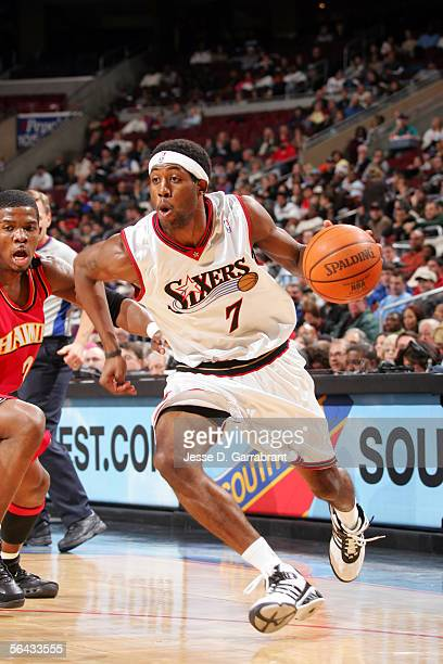 John Salmons of the Philadelphia 76ers drives against Joe Johnson of the Atlanta Hawks on December 14 2005 at the Wachovia Center in Philadelphia...