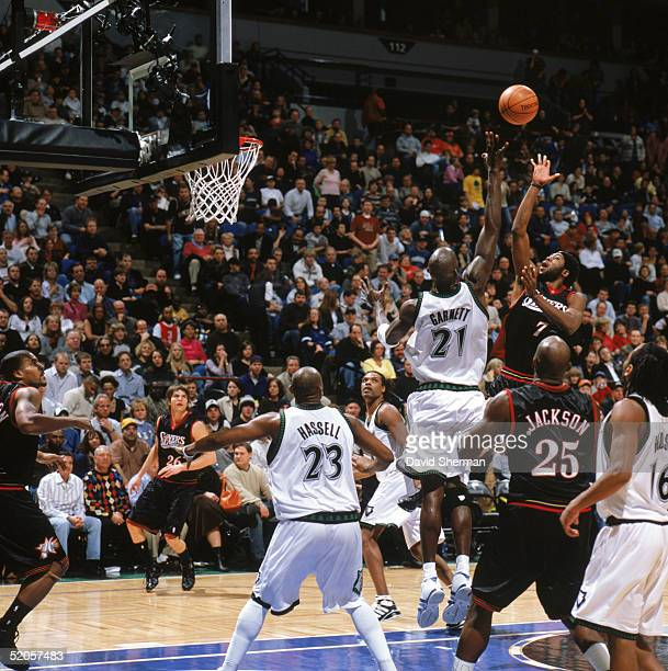 John Salmons of the Philadelphia 76ers shoots over Kevin Garnett of the Minnesota Timberwolves during a game at Target Center on January 7 2005 in...