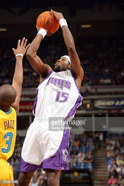 John Salmons of the Sacramento Kings takes the pullup jump shot against Chris Paul of the New Orleans/Oklahoma City Hornets on October 24 2006 at...